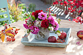 Autumnal dahlia bouquet on wooden tray