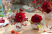 Small autumn bouquets in cups and cereal bowl