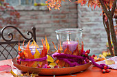 Preserving jars used as lanterns with colorful autumn leaves