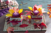 Wooden box with colorful autumn leaves decorated as lanterns