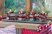 Advent wreath with a difference - red candles in numbered birch pots