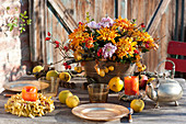 Autumn arrangement in copper jardiniere as table decoration
