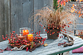 Wreath of malus branches with fruits and lanterns