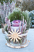 Advent decoration outside with broom heath and straw star