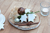 Small Advent and Christmas decoration on birch slice, cinnamon stars