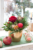 Advent arrangement with pink, twigs of Pinus