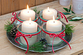 Simple Advent wreath made of preserving jars as a candle holder