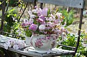 Romantic spring bouquet in grandmas old coffee pot