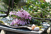 Fragrant bouquet of Hyacinthus 'Pink Pearl', and branches