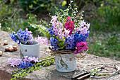 Hyacinthus (Hyacinth) and Prunus spinosa (sloe) in planters