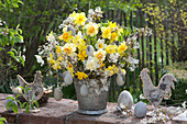 Yellow-white spring bouquet in zinc pot