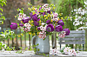Fragrant spring bouquet of Tulipa 'Purple Prince', and twigs