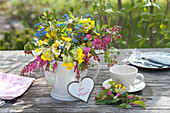 Colorful spring bouquet in coffee pot,