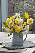 Bouquet of mixed Narcissus, common hornbeam branches