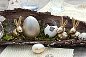Unusual Easter table decoration with golden easter bunnies
