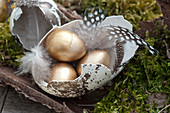 Unusual Easter table decoration with golden Easter eggs