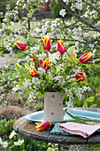 Spring bouquet in pitcher, Tulipa 'Synaeda King'