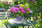 Arrangement of Rose, syringa, euphorbia