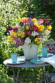 Lush syringa vulgaris and mixed tulipa bouquet