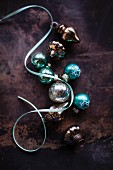 Turquoise and silver Christmas tree baubles and pale blue ribbon