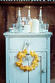Wreath of shortcrust stars and candles on vintage cabinet