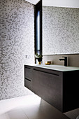 Modern vanity unit in the bathroom with mosaic tiles