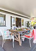Festive table with concrete slab on the veranda