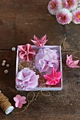 Pink origami flowers and lilac fabric flowers