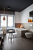 Industrial-style accessories in large bathroom in shades of brown