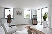 Jukebox in corner of white minimalist living room