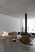 Hanging fireplace in minimalist living room