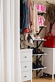 Feminine accessories in walk-in wardrobe in bedroom