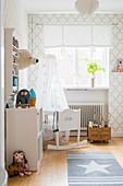 Cradle in bright nursery