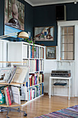 Rotating shelves and bookcase filled with books and records