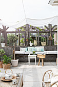 Summery veranda with half-open wall below awning