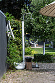 Garden shower on wooden post