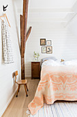 Apricot blanket on bed in rustic bedroom