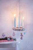 Lit candles on festive, DIY, concrete wreath