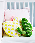 Crocheted cactus and pillow with yellow dots and pink frills
