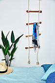 Rope ladder as a coat rack in the bedroom