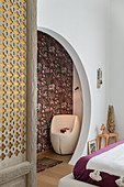 Round open doorway in bedroom with exotic accessories