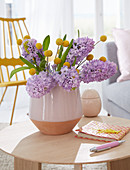 Vase of hyacinths and craspedia