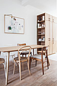 Various wooden chairs around simple dining table