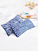 Rectangular cushions with blue and white batik covers