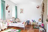 White bed in girl's bedroom