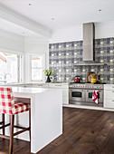 Large modern country kitchen with blue patterned tiles