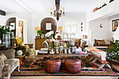 Ethnic style living room with orchids on the coffee table