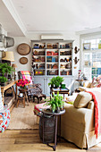 Colorful mix of styles in the living room with old books and houseplants