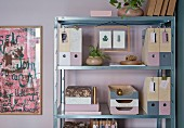 Decoupaged and painted filing system on metal shelves