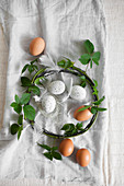 Brown eggs, white speckled eggs and wreath of blackberry tendrils